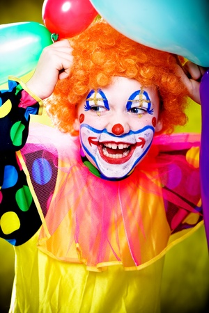 stage costume: little girl dressed up as a clown