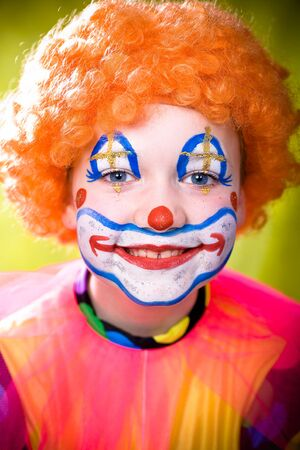 little girl dressed up as a clown photo