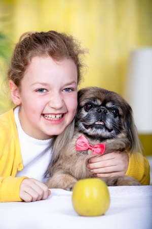 pekingese: young girl with a pekingese dog