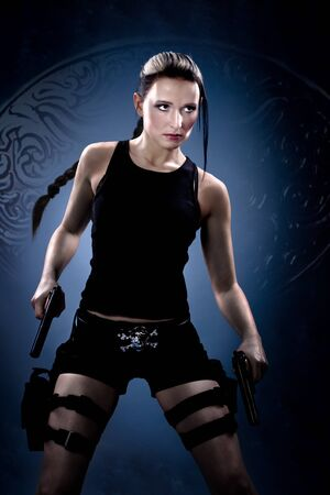 fictional character: A young woman dressed like the tomb raider Stock Photo
