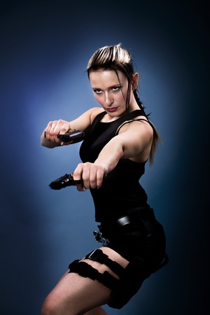 croft: A young woman dressed like the tomb raider Stock Photo