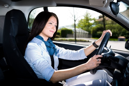 Driving a car: a young woman driving the car