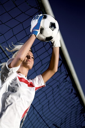 scoring: goalkeepers hands holding a soccer ball