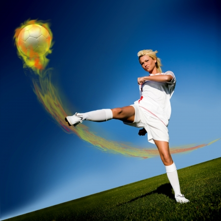 scoring: female soccer player on the field Stock Photo
