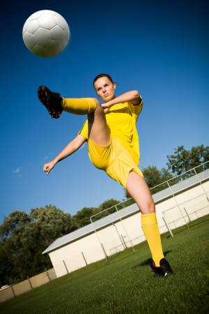 female soccer: female soccer player on the field Stock Photo