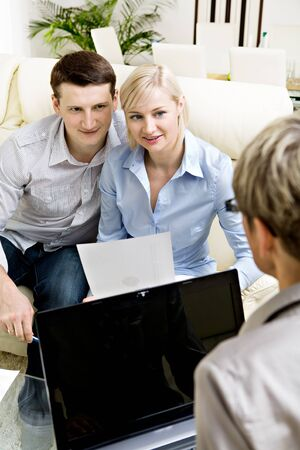 a female consultant at visiting young family photo