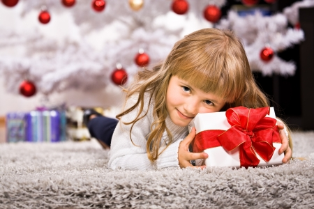 a little girl geting the Christmas gift photo