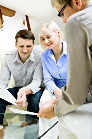 a female consultant at visiting young family Stock Photo