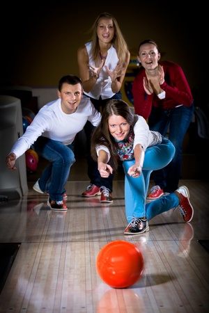 a young woman playing bowling Stock Photo