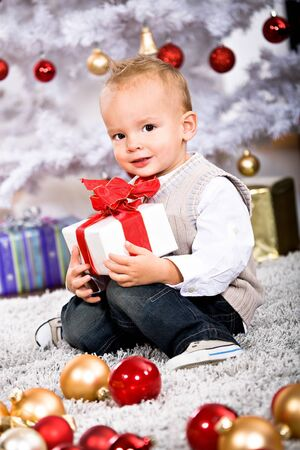 a little boy geting the Christmas gift photo