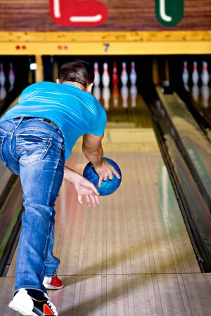 a young man playing bowling Stock Photo