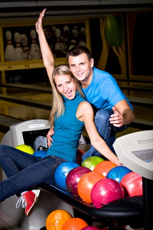 a young couple playing bowling photo