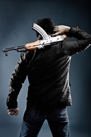 masked terrorist with a kalashnikov submachine gun