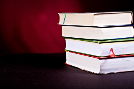 bibliomania: close up shot of a stack of books Stock Photo