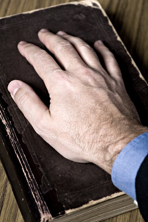 bibliomania: the oath with hand on the Holy Bible