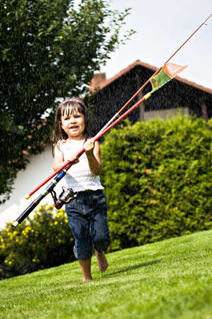 a little girl with angling rod in the rain photo