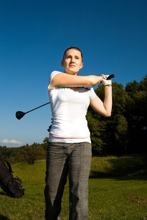 female golf player with a golf club Stock Photo - 11580128