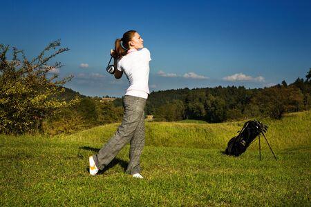 female golf player with a golf club photo