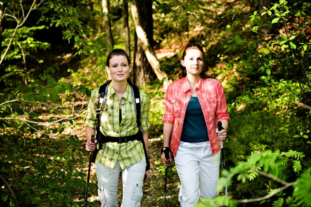 two young women Hiking In The Wild Nature Stock Photo - 11955841