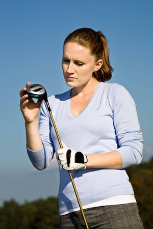 female golf player with a golf club Stock Photo - 12015237
