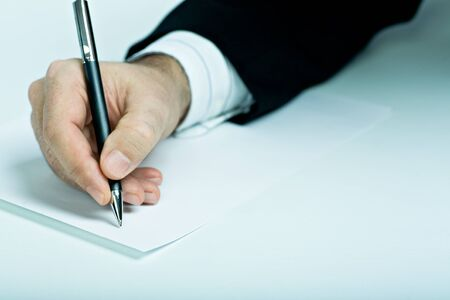 Symbilic picture. Suited man signing a contract. photo