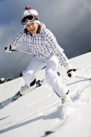 A young woman skiing in the Alps, outdoor shoot. photo