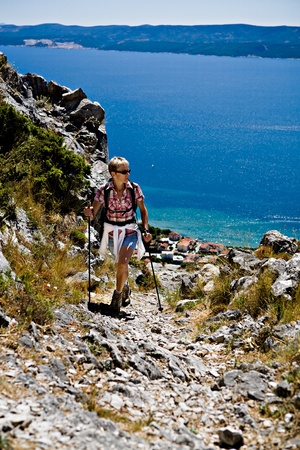 adriatic: A woman hiking at the Adriatic coast Stock Photo