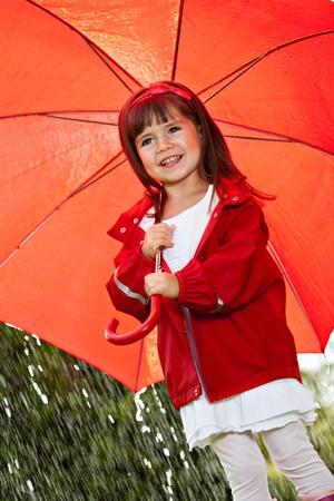 rain umbrella: portrait of a little girl with umbrella