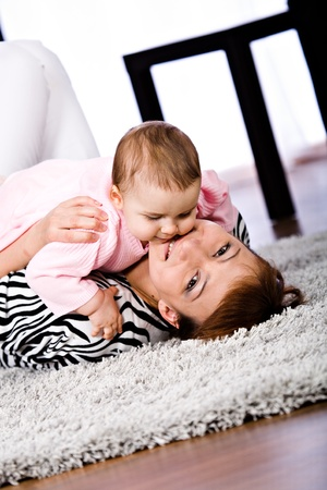 a mother and baby daughter studio portrait photo