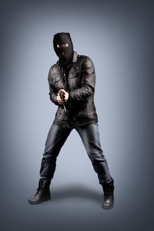 masked terrorist with a kalashnikov submachine gun Stock Photo - 12148552