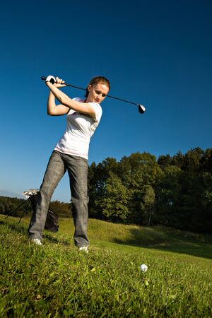 female golf player with a golf club photo