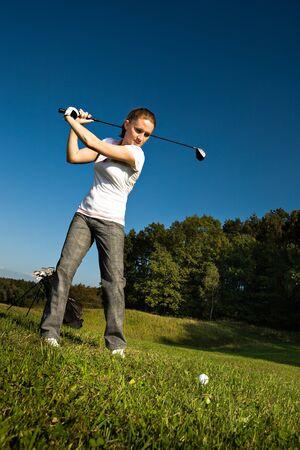 female golf player with a golf club