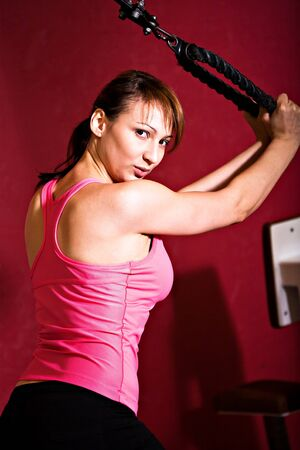 gym dress: young woman in sport dress at the gym