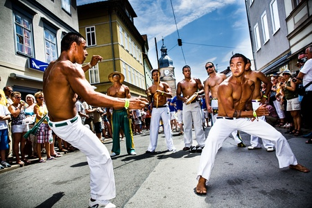 COBURG, GERMANY - JULY 11: An unidentified male capoeira dancers participates at the annual samba festival in Coburg, Germany on July 11, 2010. Editorial