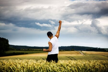 man jogging through the fields
