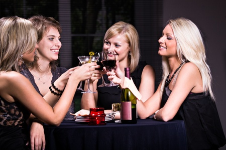 bar interior: group of a young women in the restaurant Stock Photo