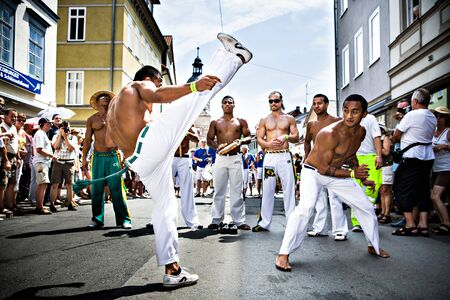 COBURG, GERMANY - JULY 11: The unidentified male capoeira dancers participates at the annual samba festival in Coburg, Germany on July 11, 2010. Editorial