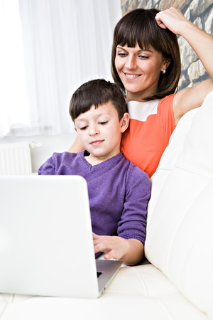 a young woman and her son surging internet in the living room photo