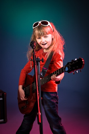 portrait of young girl with a guitar on the stage Imagens - 13056007