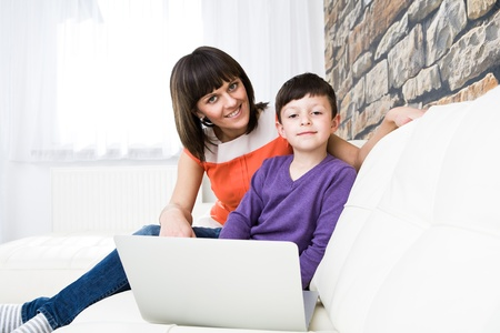 home safety: a young woman and her son surging internet in the living room