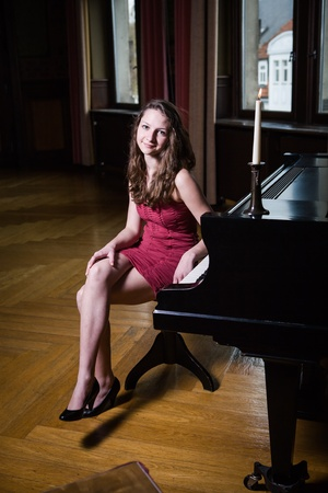 indoor portrait of a young female piano player photo