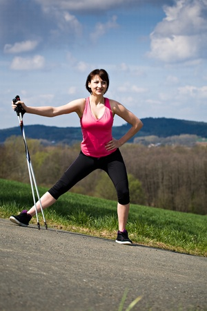 A young woman stretching for nordic walking photo