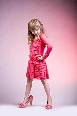 mode: portrait of young girl as a fashion model on the stage
