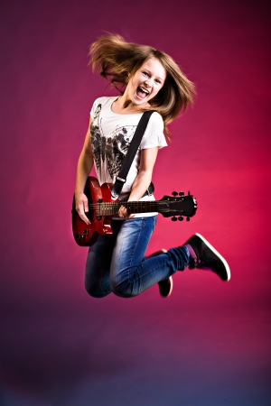 string instrument: portrait of young girl with a guitar on the stage