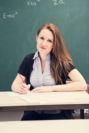 portrait of a young female teacher in the classroom Stock Photo - 13636493