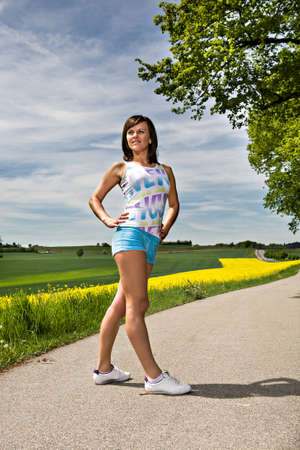 A young woman stretching for jogging photo