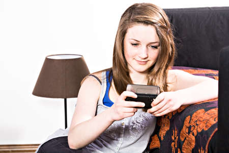 teenage girl with a cellphone at home Stock Photo - 13736503