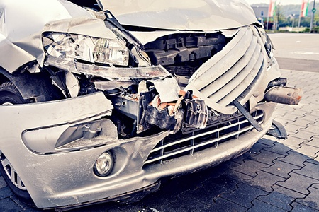 a demolished car after an accident on the street