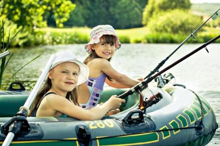 little girls fishing on lake at summer Imagens - 14017440