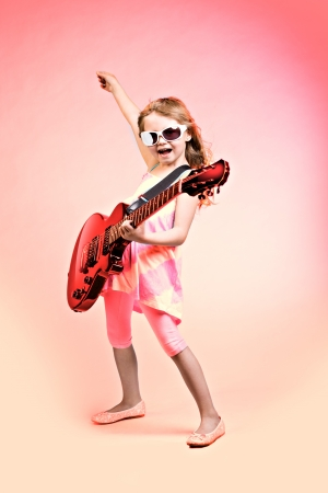 song: portrait of young girl with a guitar on the stage